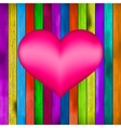 Love symbol on old colorful wooden wall EPS8 vector image