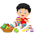 Little boy painting an Easter egg vector image