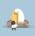 Businessman painting golden color on the egg vector image