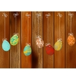 Easter eggs on a wooden wall  EPS8 vector image vector image