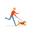 happy red-haired man with dog on morning jogging vector image