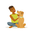 happy teenager boy stroking friendly brown puppy vector image