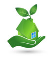 green house in hand ecology symbol vector image