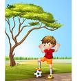 A boy with a soccer ball vector image