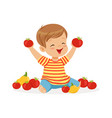 happy little boy sitting on the floor playing with vector image vector image