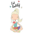 Girl eating healthy holding a basket of fruit vector image