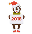 husky dog in christmas hat holds placard with 2018 vector image
