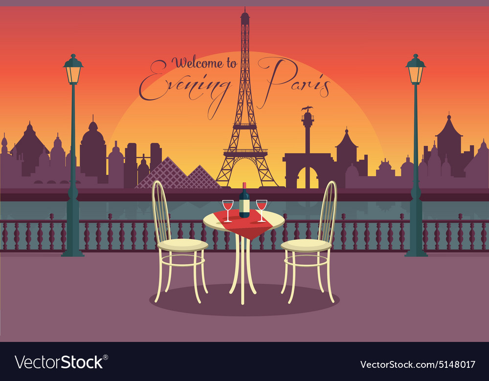 View of evening paris from the cafe vector
