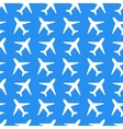 White plane icons on blue background seamless vector image