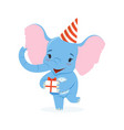 cute baby elephant in a party hat holding gift box vector image