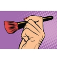 Make-up brush in hand vector image
