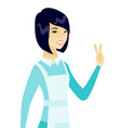 young asian cleaner showing victory gesture vector image