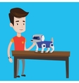 Happy young man playing with robotic dog vector image