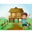 A boy waving his hand in front of a nipa hut vector image vector image