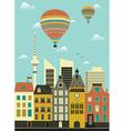 Hot air balloon over city vector image