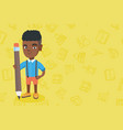 african kid boy standing with a huge pencil vector image