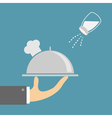 Hand with silver platter cloche chef hat and salt vector image