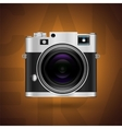 Classic camera icon on brown background vector image