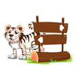 A tiger at the back of a wooden signboard vector image vector image