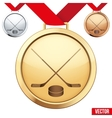 Gold Medal with the symbol of ice hockey inside vector image