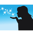 Silhouette of woman blowing snow vector image