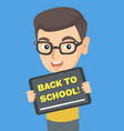 schoolboy holding tablet with text back to school vector image