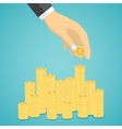 Hand put coin to stacks of golden coins vector image