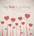 Growing hearts on crumpled paper vector image
