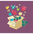 Christmas decorations falling into a box vector image vector image