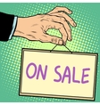 Hand holding a sign on sale vector image