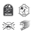 Retro skiing labels emblems and logos set vector image
