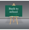 Green school board with chalk on a tripod vector image