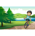 A boy biking near the pine trees at the riverside vector image