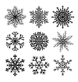 Set of black paper snowflakes vector image