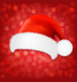 red background with santa claus cap vector image