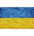 Grunge flag of Ukraine on a brick wall vector image