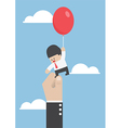 Businessman flying away with balloon but being hin vector image