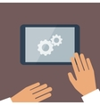 Tablet pc in process and human hands vector image