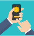 hand holding smartphone with bitcoins on screen vector image