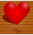 Heart on a wooden background vector image vector image