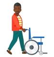 Man pushing wheelchair vector image