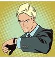 People in style pop art A man looks at his watch vector image