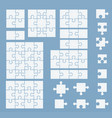 parts of puzzles on blue template vector image
