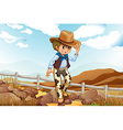 An adventurer above the hill near the rocky area vector image