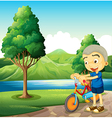 A cute little boy playing with his bike vector image