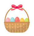 basket with painted eggs easter basket icon flat vector image