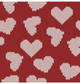 Knitted background with the image of hearts vector image