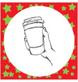 Hand holding disposable coffee cup vector image