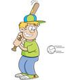 Cartoon boy hitting a baseball vector image