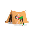 young smiling teenager boy setting up tourist tent vector image